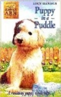 Image for Puppy in a puddle