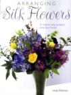 Image for Arranging silk flowers  : 35 step-by-step projects using faux florals